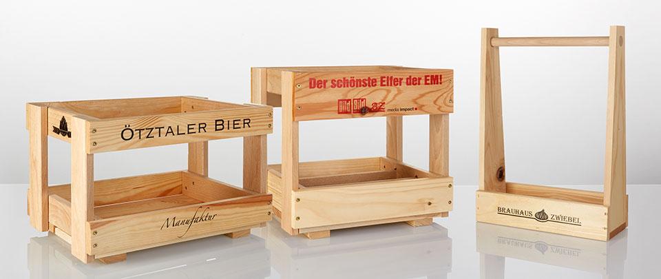 [Translate to Italienisch:] Flaschenkästen aus Holz